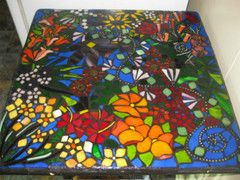 Get answers to commonly asked mosaic questions like: Can you mosaic onto wood when making an outside mosaic? Q. My grout is cracking, why is does this happen and what can I do to prevent it? Q. I am a really bad drawer, how can I come up with a design? Just visit this page. Mosaic Tabletop by Jackie Perry
