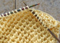 "Bee Stitch = The Bee Stitch is a multiple of 2 stitches plus 1 over 4 rows. It is made by ""knitting 1 below (K1b)"" and you need to have an odd number of stitches. Row 1: Knit Row 2: (Right Side): *(K1, K1b); Repeat from * across to last stitch K1. Row 3: Knit Row 4: *(K1b, K1); repeat from * across to last stitch, K1b."