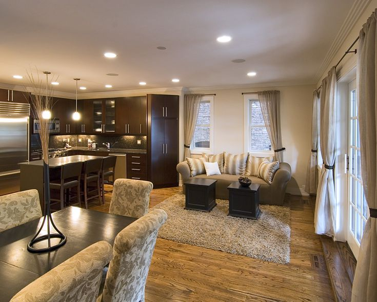 dark kitchen - open concept with living room and dining room
