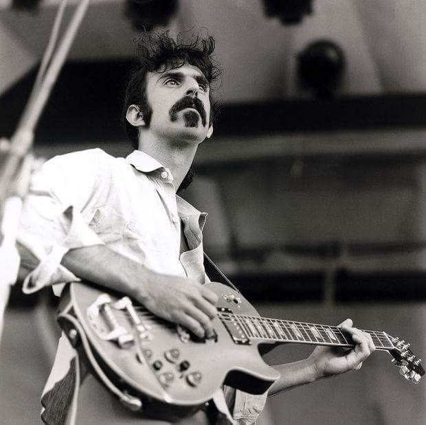Frank Zappa playing a Gibson Les Paul, 1969 Newport Jazz Festival (copyright)~ David Redfern/ Getty Images.