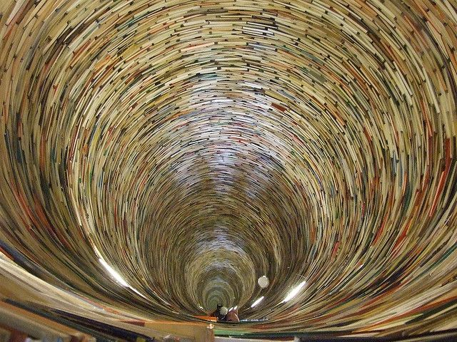 The hall of the main library in Prague is dominated by a giant tower of books - a monument made out of old novels from the library. It rises more than 5 metres in the air. In the bottom, there is a mirror, creating the effect of a deep, deep well of wisdom.