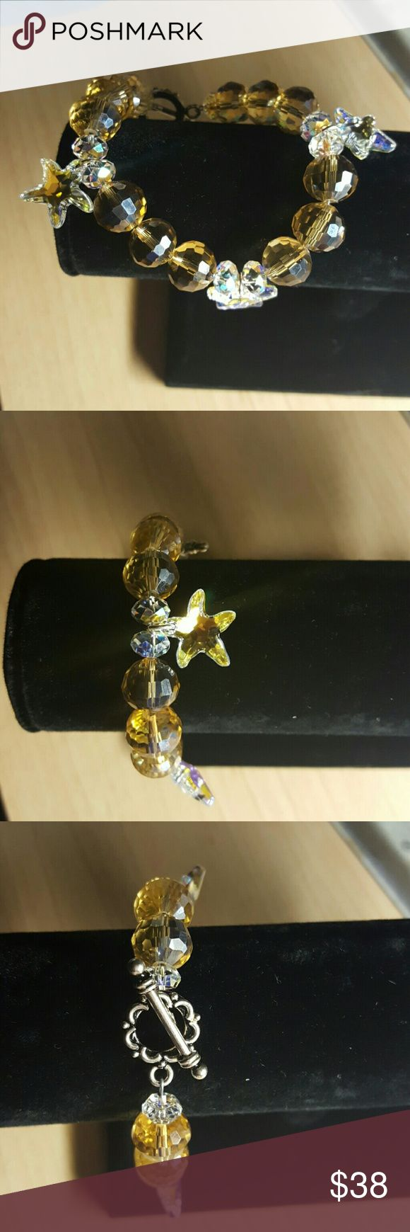 "SWAROVSKI STARFISH BRACELET Pretty gold chessboard 12mm Chinese crystals, THREE 16mm Swarovski AB CRYSTAL STARFISH with Rondelle AB SWAROVSKI CRYSTALS. Clasp is sterling silver. Bracelet measures 8"" long Jewelry Bracelets"