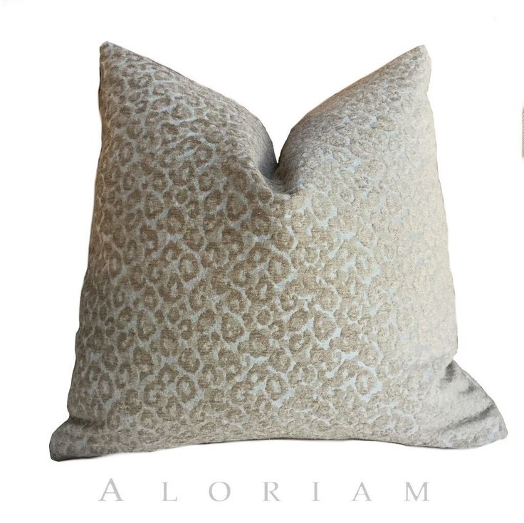 This pillow cover is made from a heavyweight designer fabric featuring a two-tone leopard skin pattern. The spots have a raised fuzzy texture with a wonderful dimensionality. The neutral taupe and lig