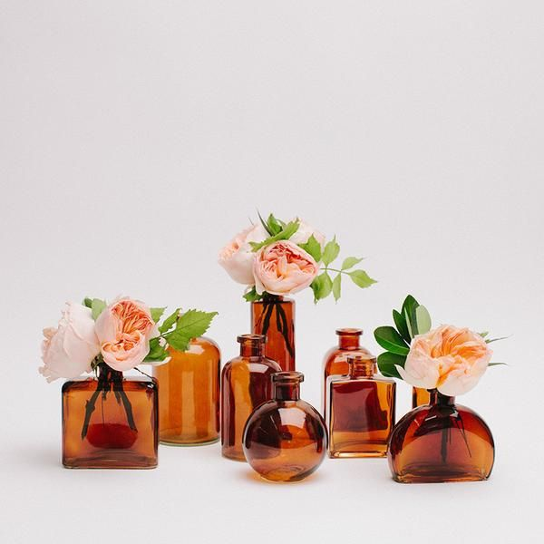 "Our lovely amber apothecary bottle collection includes 9 bottles ranging from about 4"" to 7"" in height. We have selected our favorite shapes and created this adorable grouping, perfect for any event c"