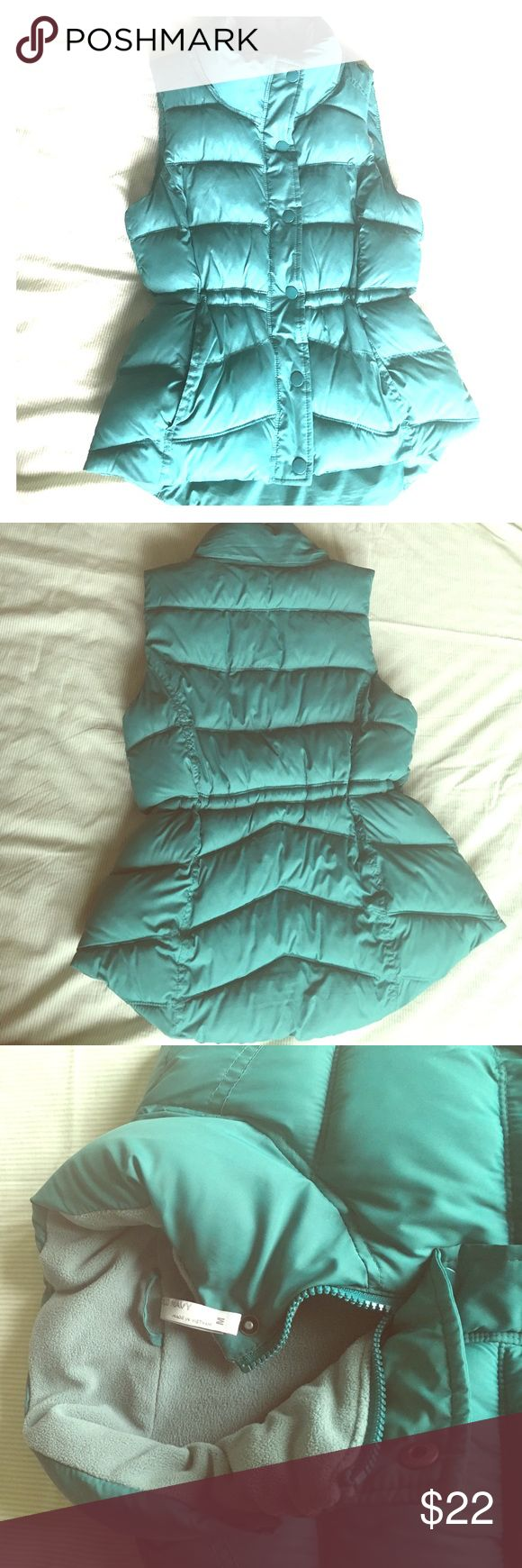 Old Navy fitted puffer vest Turquoise/teal color, worn twice, warm, zipper and snap buttons, cinchable waist, high/low style, great condition! Old Navy Jackets & Coats Vests