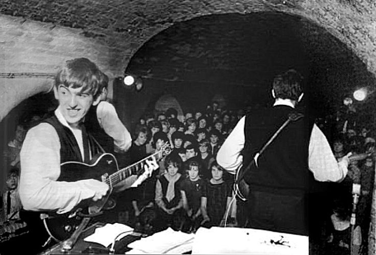 George turns to make sure Ringo hasn't nipped out to The Grapes again, over the alley from the Cavern club in Mathew Street, Liverpool. http://winstonlennon.com