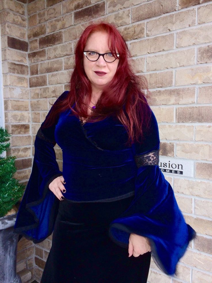 A personal favorite from my Etsy shop https://www.etsy.com/ca/listing/250716509/dark-blue-stretch-velvet-gothic-top