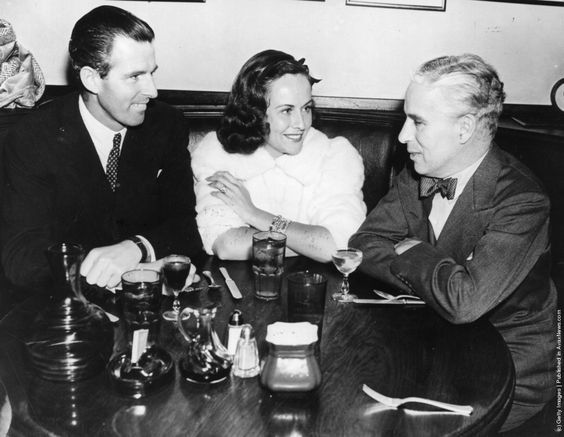 Tim Durant rumored to be married to Paulette Goddard is seen with her and Charles Chaplin, at the Brown Derby Restaurant, 1935.