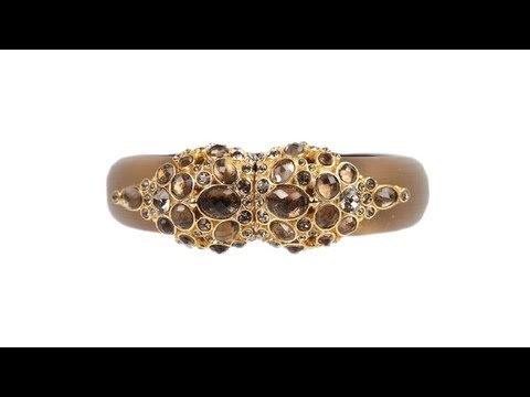 To buy now click on the link: http://shrsl.com/?~3fs1  The #Alexis #Bittar #Gold #Lucite #Design #Bangle features a gold lucite bangle with yellow gold platted center design encrusted with #Swarovki #crystals and #brown #gemstones. Bangle has a total height of 0.9 inches. Fits a small to medium size wrist.