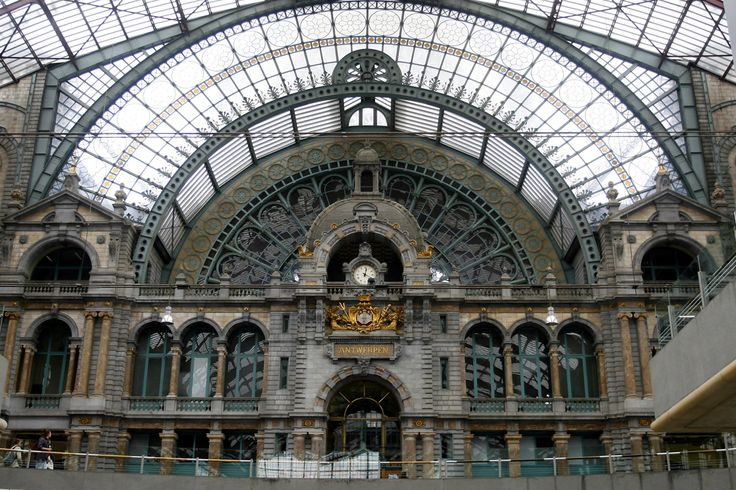 The Antwerp Central Train Station (Antwerpen-Centraal or Gare Centrale d'Anvers) is the main station located in Antwerp, Belgium. It is widely considered to be one of the most beautiful train stations in the world, built between 1895 and 1905 to replace the old wooden train station built in 1854. The main building was designed by architect L. Delacenserie. The interior is lavish, using more than 20 different varieties of marble and stone. The platforms themselves are covered by a huge iron…