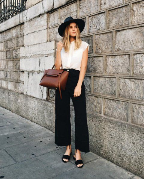 Wool hat paired with denim culottes, a white blouse, and sandals.
