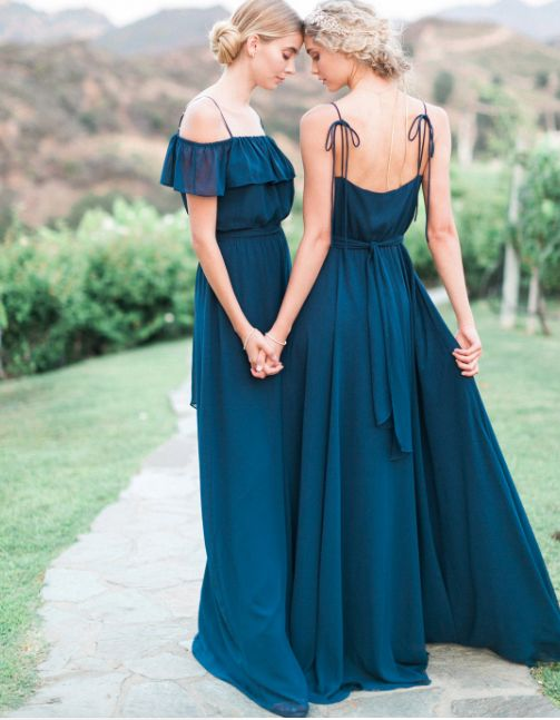 A soft bow and tied straps creates a sweet and feminine bridesmaid look. Gown: Ceremony by Joanna August. Image: Bella Bridesmaids