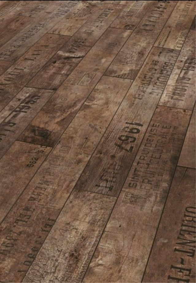 laminate flooring - I even like this one...looks like made from old packing crates. Cool!