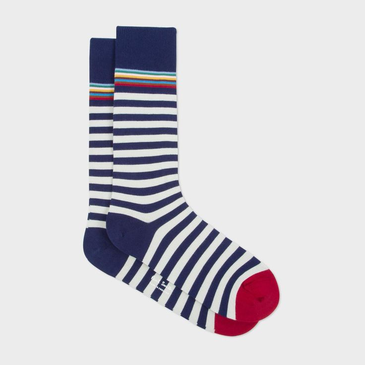 Paul Smith men's navy and white stripe socks with a multistripe trim at the top. Made in England from a soft cotton blend, these socks are finished with a contrasting pink toe and a navy ribbed cuff.