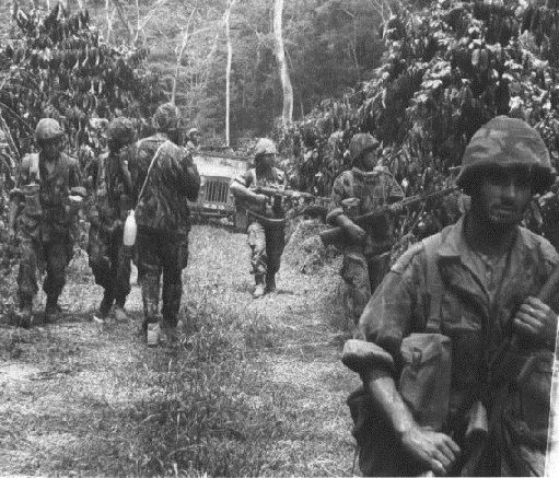 "Portuguese colonial war [1961 to 1974] in Angola, Guinea-Bissau and Mozambique (The Portuguese Vietnam war). This pic is from early in the war - the soldiers wear helmets and FN Fal rifles. The helmets would soon be dropped in favor of Bigeard ""lizard-type"" caps, and the FN would be replaced by the G3 rifle."