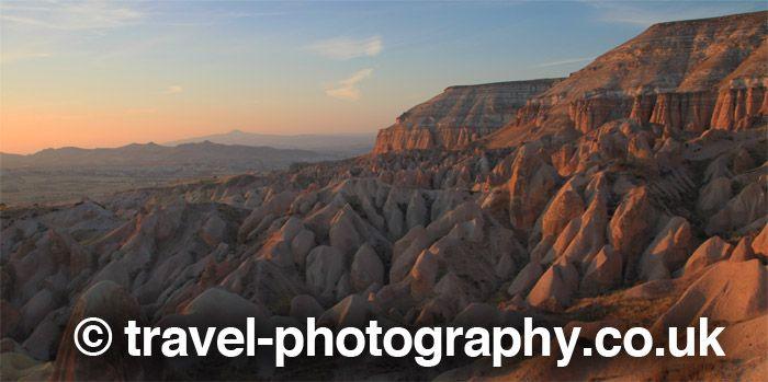 Sunset over Cappadocia cliffs