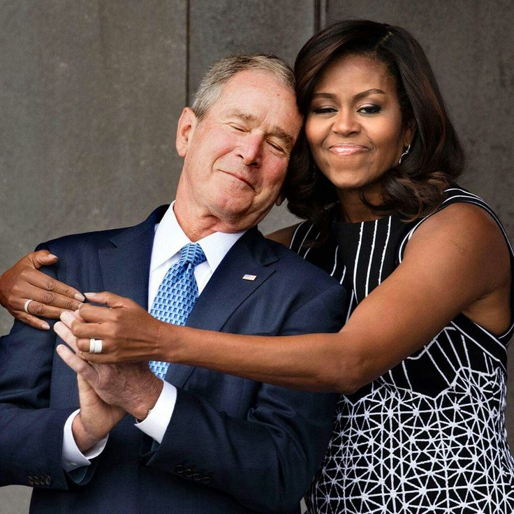 A much-needed sign of political civility: First Lady Michelle Obama gives former President George W. Bush a big hug at the opening of the National Museum of African American History and Culture today. President Bush signed the bill authorizing the NMAAHC in 2003. For more photos check out kennerly.com