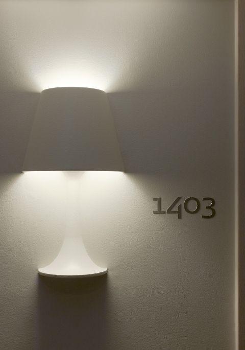 Brilliant lamp in wall at hotel Scandic Victoria Tower in Stockholm, Sweden. Design by Philippe Starck.