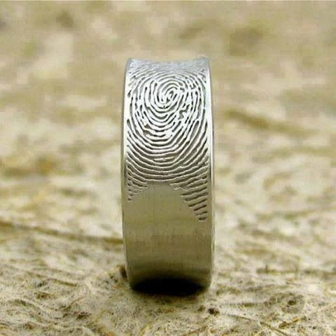 Love love, love!  His wedding band with her fingerprint.