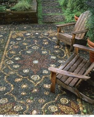 Amazing outdoor patio rug made with rocks! What a great idea for a garden.