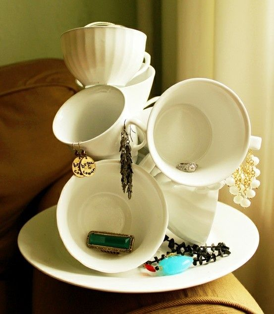 Tea cups and saucer glued together repurposed into vintage jewelry display piece, perfect for arts and crafts shows, retail store display cottage style; Upcycle, recycle, salvage, diy, repurpose! For ideas and goods shop at Estate ReSale  ReDesign, Bonita Springs, FL