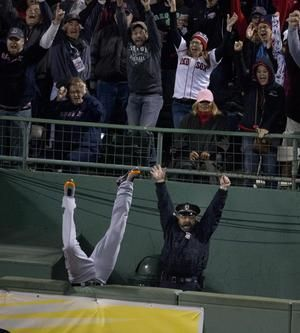 "Pure Boston sports magic. Detroit Tigers' Torri Hunter's legs and bullpen officer Steve Horgan's arms form a 'W"" as David Ortiz's home run blast travels over the wall to tie ALCS 2013 game 2. Sox win it 6 to 5!"