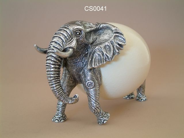 Pewter elephant and ostrich egg decor.