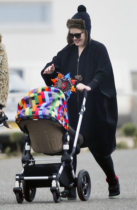 Adele enjoys a stroll with her son #justlikeus