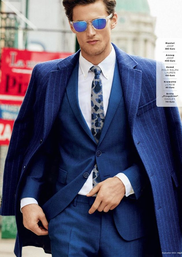 Pea Coat Over Shoulders Of Suit With Shades Shoptalk