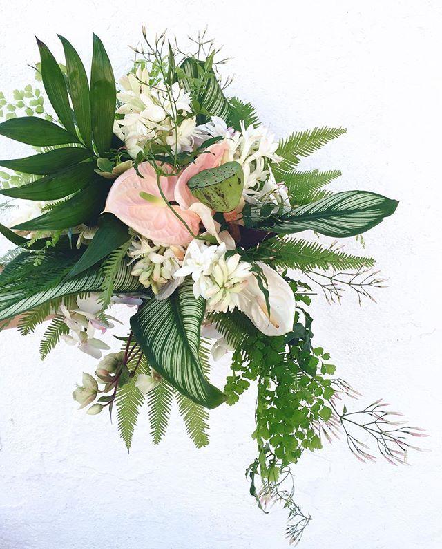 Yesterday's bridal bouquet with jasmine, calathea, anthurium, lotus, hellebore, tuberose, phalaenopsis, and ferns
