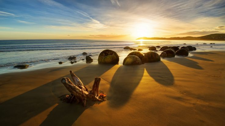 1366x768 Обои new zealand, новая зеландия, океан, восход, камни, побережье