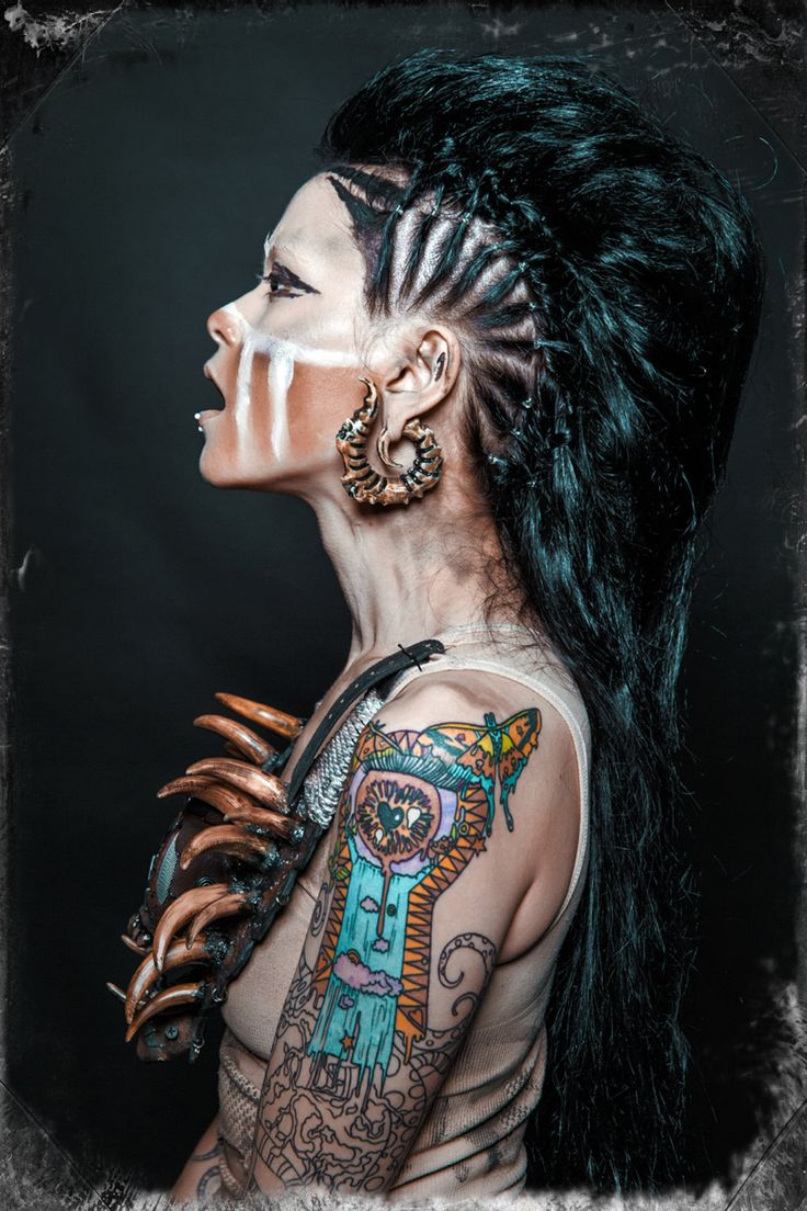 Tribal inspired tooth necklace and make up with faux hawk