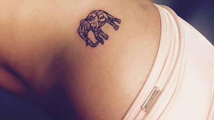 Hip tattoo of an elephant on Emily.