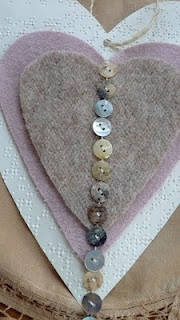how pretty...made with felted sweaters, buttons and vintage Braille paper