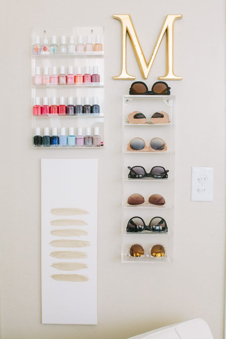 The sunglasses wall organizer was found on Amazon.
