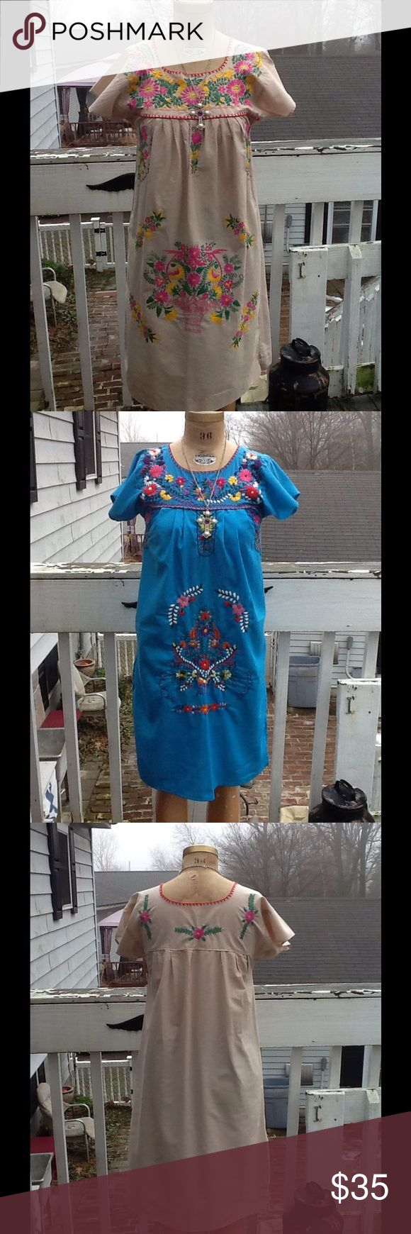 """Bundle of 2 VTG Embroidered MEXICAN Dresses Nice lot of 2 VTG embroidered MEXICAN boho festival dresses,perfect little summer dresses but make beautiful maternity dresses as well,1 is in tan other is in a pretty turquoise blue,beautiful embroidery all hand done,some light staining on tan May come out with some shout in wash..I'm no longer posting condition EUC,MINT,BEAUTIFUL any longer due to too many ppl making up lies in order to return an item..sold as is! Any ?s ask! Measurements: L:38""""…"""