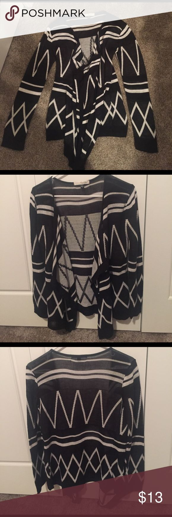 Tribal print cardigan Cute and comfy black and white tribal print cardigan! Size M but fits like a S. In perfect condition! Feel free to make me an offer! Sweaters Cardigans
