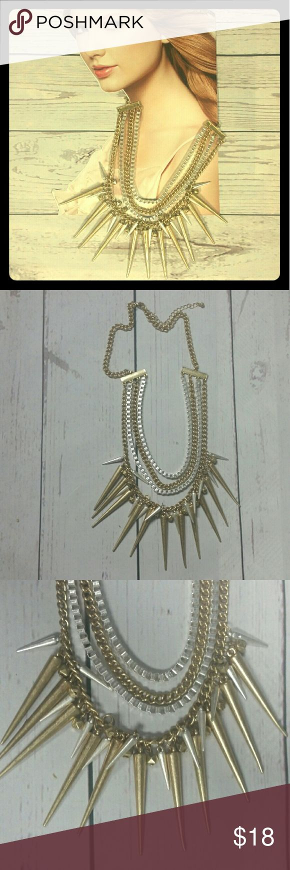 Spiked necklace!!! Give a touch of rock and roll to any outfit with this spiked necklace. Spiked gold and silver color necklace. Never worn. Jewelry Necklaces