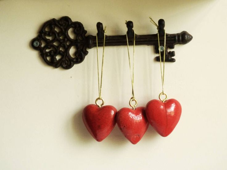 Small hearts in red Raku glaze with gold thread - approx 5 cm
