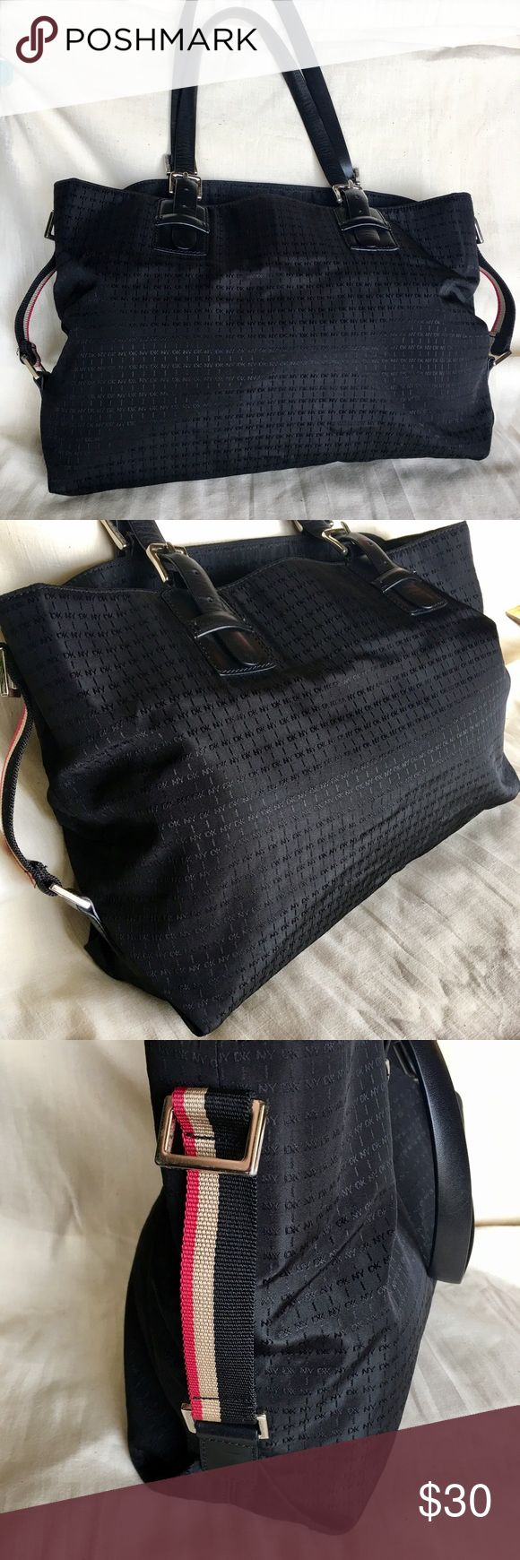 """DONNA KARAN NYLON /LEATHER LARGE SIZE HANDBAG Lightweight, Preowned in excellent condition!  This versatile authentic bag by DKNY Made in INDONESIA . Black Nylon /Leather has three inside pockets,middle one has zipper . One side zipper pocket. All zipper fully functional . Bag is in perfect condition and doesn't have any damage and completely clean. Measurements H10,5"""".  L14"""".  D4"""".  Straps drop 9,5"""" DKNY Bags"""