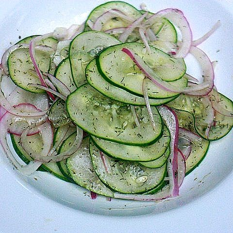 1 Large Cucumber     1/2 Medium Red Onion     1/4 cup Red Wine Vinegar     1/4 cup olive oil     1 tablespoon Dill     1 tablespoon sugar      Slice cucumber and red onion.     In a separate bowl combine sugar and vinegar     While whisking add olive oil in a stream until the vinagrette comes together.     Pour over cucumber and red onion.     Add dill and salt and pepper to taste