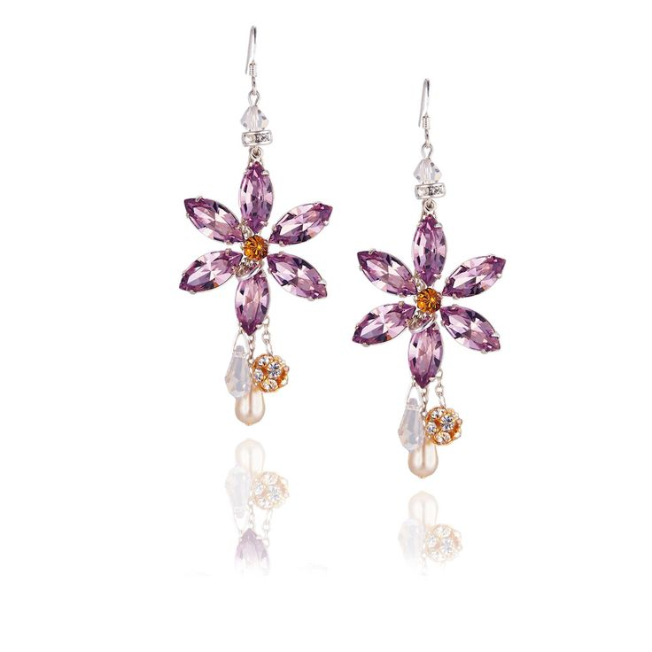 Arlequin (more colors) Stunning Swarovski crystal flower earrings with sparkling crystal drops and a crystal encrusted ball. Each facet of each petal reflects light, creating brilliant radiance and effortless glamour. Available in a range of colours. www.jyjewels.com