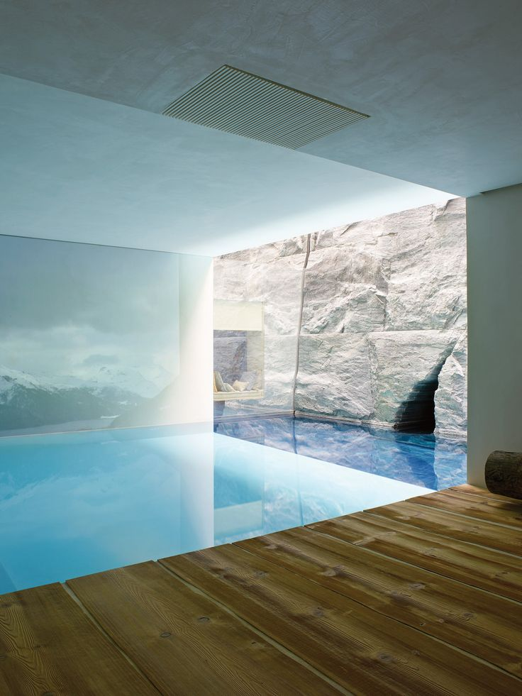 The underground spa of VistaJet chairman Thomas Flohr's mountain chalet in St. Moritz features a live projection of the neighboring Engadin valley over the pool and a spherical indoor grotto cut into a serpentino stone wall. (Photo: Henry Bourne)