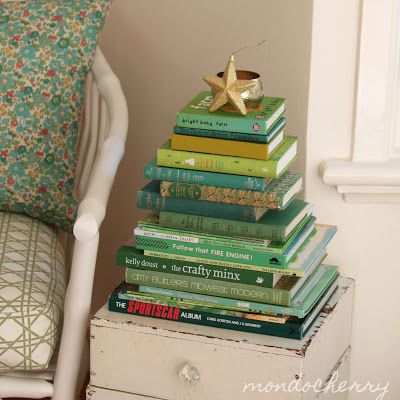 "Great ""Christmas tree"" made from books for a small space! Very creative"