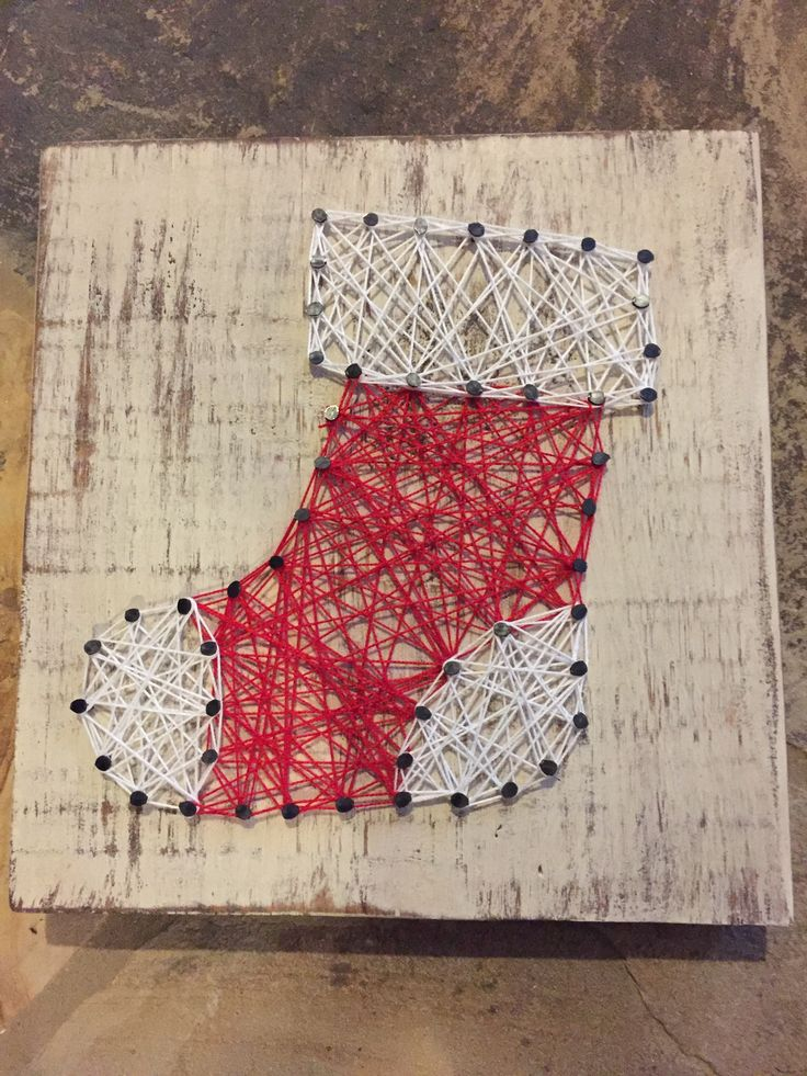 The stocking art measures 12x9 with cream distressed wood background. This stocking string art is green, red, white and black. Want a different color scheme? Let us know and we can customize color str