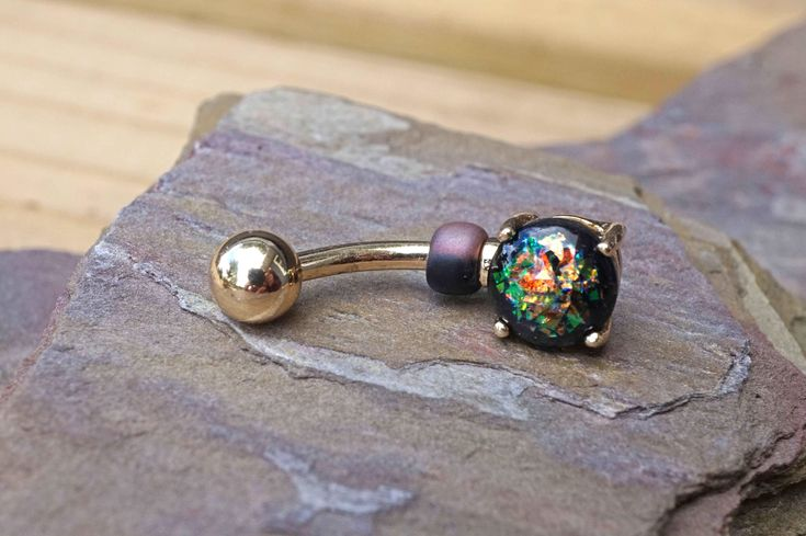 Black Opal Gold Belly Button Ring Prong Set by MidnightsMojo on Etsy https://www.etsy.com/listing/520118618/black-opal-gold-belly-button-ring-prong