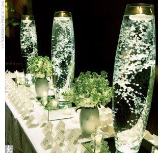 Really pretty and inexpensive! Baby's breath submerged in water with a floating candle! Really like this idea!!