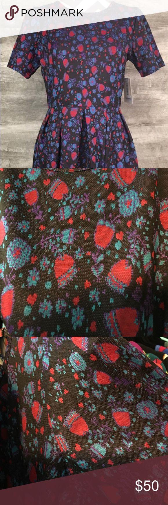 Lularoe Large Amelia Lularoe Amelia size large. Jacquard material. Black background with blue red and purple designs. New with tags. LuLaRoe Dresses
