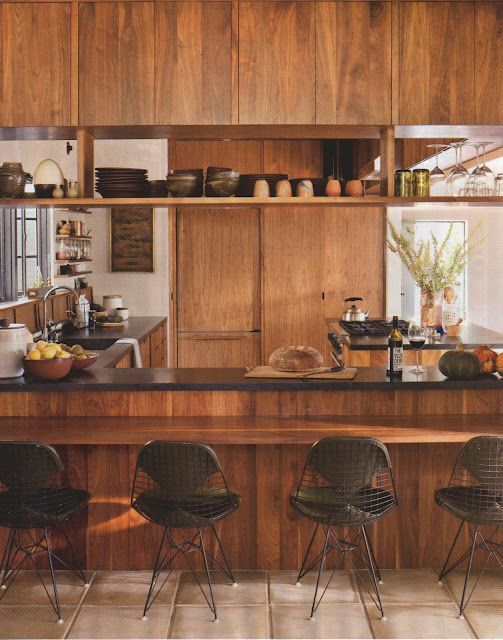 KITCHEN - Authentic mid century timber kitchen. A little OTT though great stimulus. Quite like the open shelving beneath the cupboards and seating area adjoining benchtops.