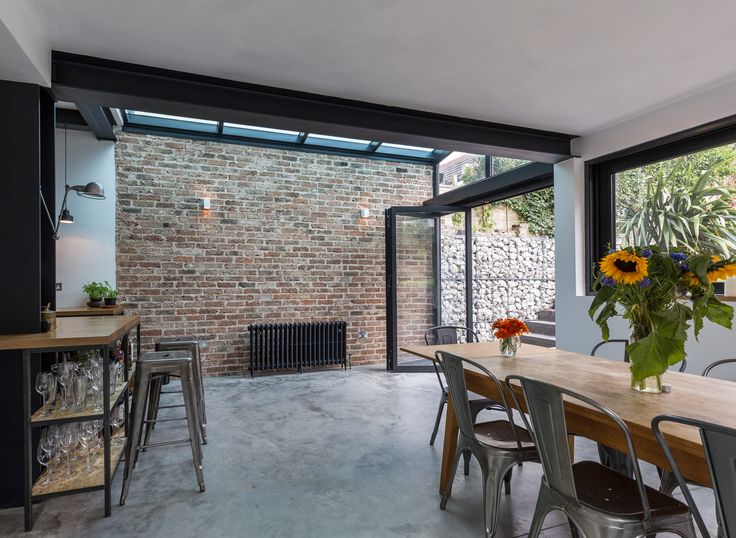 Feature internal brick wall | glass side extension roof | concrete floor | open pan living | industrial style | rustic finish | contemporary | Brighton |